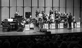 Cyrus Chestnut, jazz pianist, plays piano with the U.S. Air Force Band's Airmen of Note, during the 2016 Jazz Heritage Series performance at The Rachel M. Schlesinger Concert Hall in Alexandria, Va., Oct. 21, 2016. The Airmen of Note established the Jazz Heritage Series in 1990 and each year they perform with legendary icons of jazz. Chestnut, who has worked with many big bands, including the Lincoln Center Jazz Orchestra and the Dizzy Gillespie All-Star Big Band, was the featured guest during this series performance. (U.S. Air Force photo by Airman Gabrielle Spalding)