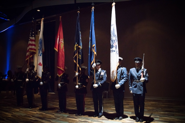 Military honor guard members from each branch of service prepare to post the colors during the 38th annual Salute to the Military Oct. 25 at the Gulf Coast Convention Center in Biloxi, Miss. (U.S. Air Force photo/Senior Airman Heather Heiney)