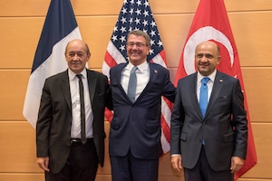 Defense Secretary Ash Carte, center, meets with French Defense Minister Jean-Yves Le Drian, left, and Turkish Defense Minister Fikri Işık at NATO headquarters in Brussels.
