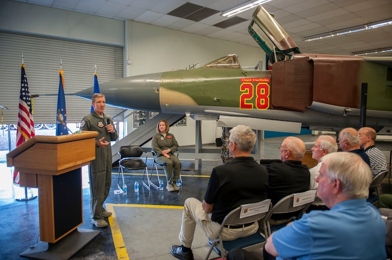 "Gen. ""Hawk"" Carlisle, commander of Air Combat Command gives a speech during a dedication ceremony at the Threat Training Facility on Nellis Air Force Base, Nev., Oct. 17. During the ceremony, a MiG-23 was dedicated to honor his role in the CONSTANT PEG program. The mission of CONSTANT PEG was to train U.S. Air Force, U.S. Navy and U.S. Marine Corps combat fighter aircrews on the best ways to fight and win when encountering MiG built aircraft in aerial combat. Carlisle was the chief of weapons and tactics as well as flight commander for the 4477th Test and Evaluation Squadron from 1986 to 1988."