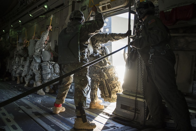 U.S. Army Alaska Soldiers assigned to the 4th Infantry Brigade Combat Team (Airborne), 25th Infantry Division, prepare to jump out of a C-17 Globemaster III during a formation flight from Joint Base Elmendorf-Richardson, Oct. 19, 2016.
