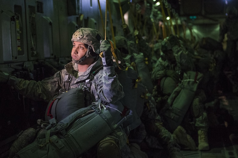 U.S. Army 1st Sgt. Shalim Guzman, assigned to the 4th Infantry Brigade Combat Team (Airborne), 25th Infantry Division, prepares to jump out of a C-17 Globemaster III during a formation flight from Joint Base Elmendorf-Richardson, Oct. 19, 2016.