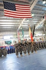 A color guard composed of Soldiers assigned to the 17th Sustainment Brigade and the 369th Sustainment Brigade, 1st Sustainment Command (Theater), present the colors for the playing of the Kuwaiti and American national anthems during a transfer of authority ceremony October 26, 2016, at Camp Arifjan, Kuwait. As the first National Guard unit to complete this mission, the 17SB transferred authority to the 369SB, a National Guard unit from New York. (Army National Guard photo by Sgt. Walter H. Lowell)