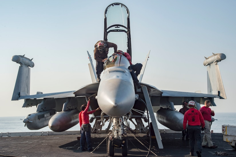 Sailors conduct pre-flight inspections on an E/A-18G Growler assigned to Electronic Attack Squadron 130 on the flight deck of the aircraft carrier USS Dwight D. Eisenhower in the Persian Gulf, Oct. 18, 2016. Ike and its Carrier Strike Group are deployed in support of Operation Inherent Resolve, maritime security operations and theater security cooperation efforts in the U.S. 5th Fleet area of operations. Navy photo by Petty Officer 3rd Class Robert J. Baldock