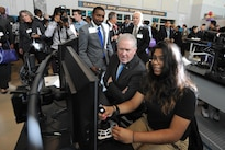 Frank Kendall, undersecretary of defense for acquisition, technology and logistics, watches a student perform simulated remote pilot operations during demonstrations at the Flexible Aviation Classroom Experience lab at Francis L. Cardozo Education Campus in Washington, D.C., Oct. 20, 2015. DoD photo by Marvin Lynchard