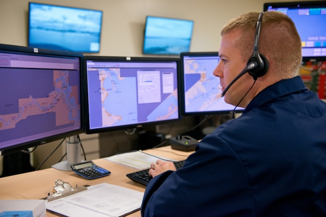 A Chief Petty Officer speaks to local mariners requesting navigational assistance, at Sector Houston-Galveston. The Coast Guard provides these services in major ports throughout the United States as a way of communicating to various mariners about port conditions that would affect safe transit in and out of ports and waterways. (U.S. Coast Guard photo by Petty Officer 3rd Class Jennifer A. Nease)
