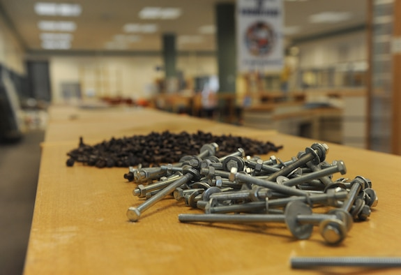 Construction hardware sits on a shelf at the McBride Commons Oct. 24, 2016, on Keesler Air Force Base, Miss. The renovation project will transform the former base library into a common area housing a children's library, computer stations, engraving, framing, marketing and print shops and a full kitchen. The nine-month project is expected to be completed by May 2017. (U.S. Air Force photo by Kemberly Groue/Released)