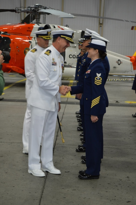 Commanders conduct a uniform inspection of the crew during Coast Guard Air Station Sitka's change of command ceremony in Sitka, Alaska. (U.S. Coast Guard Photo by Petty Officer 3rd Class Lauren Steenson)