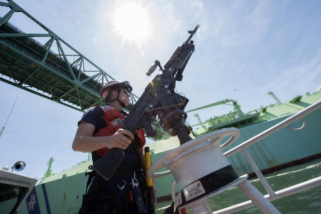 A 3rd Class Petty Officer, a crewmember of Coast Guard Station Boston, is underway aboard a 45-foot response boat during a security escort in Boston Harbor. The station's crew escorted the Norwegian-flagged LNG (liquefied natural gas) tanker BW GDF SUEZ Boston into a terminal in Boston. (U.S. Coast Guard photo by Petty Officer 2nd Class Cynthia Oldham)