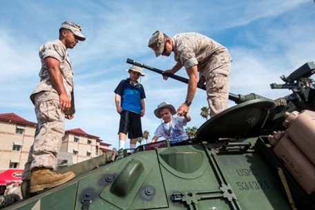 U.S. Marines showcase their equipment to family and friends following the de-composite ceremony of the 13th Marine Expeditionary Unit, aboard Camp Pendleton, Calif., Oct. 7th, 2016. The ceremony signified the completion of a seven-month deployment to the U.S. 5th and 7th Fleet areas of operation with the Boxer Amphibious Ready Group. The 13th MEU will formally relinquish operational control of ground combat, aviation combat, and logistic combat elements. (U.S. Marine Corps Photo by Pfc. Tyler Byther/ Released)