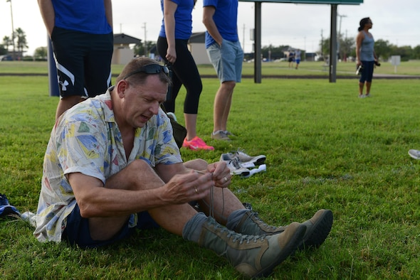 Col. Brian Hinsvark, 47th Mission Support Group commander, laces up his boots for the ruck portion of Laughlin's Wingman Challenge on Laughlin Air Force Base, Texas, Oct. 15, 2016. After completing a 5k run, Hinsvark and his wingman Col. Thatcher Cardon, 47th Medical Group commander, rucked an additional 5k with various exercises throughout. (U.S. Air Force photo/Airman 1st Class Benjamin N. Valmoja)