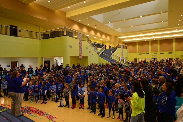 Students at Osan American Elementary School sing their school anthem after a ribbon cutting ceremony at Osan Air Base, Republic of Korea, Oct. 25, 2016. The ceremony marked the opening of the new OAES facilities after three years of construction. (U.S. Air Force photo by Senior Airman Victor J. Caputo)