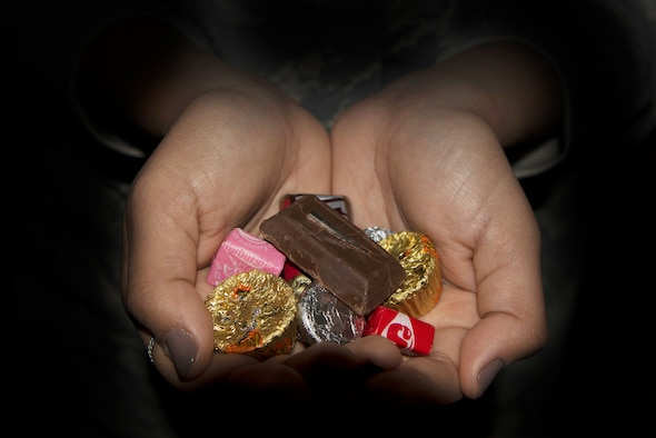 Parents and adults should inspect any treats given by a stranger, according to the American Academy of Pediatrics. Always check to see if the candy is outdated, spoiled or tampered with to keep children safe, and never eat unwrapped candy.