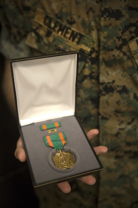 U.S. Marine Corps Cpl. Ricki D. Clement, a micro/miniature repair man with Electronics Maintenance Company, 3rd Maintenance Battalion, III Marine Expeditionary Force, displays his Navy and Marine Corps Achievement medal he received for exceptional innovation at Camp Kinser, Okinawa, Japan, Oct. 20, 2016. Clement repaired a radio tester unit using a Vehicular Amplifier Unit, saving the Marine Corps nearly $64,000 in logistics and maintenance. (U.S. Marine Corps photo by Lance Cpl. Breanna Weisenberger)