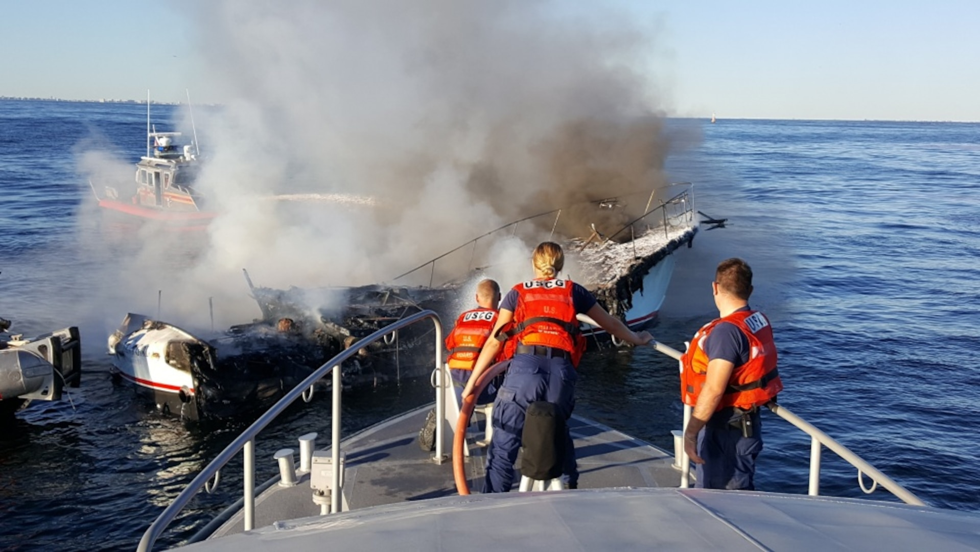A Coast Guard Station Sandy Hook boat crew and New York Fire Department Marine eight rescue crew responded to a boat fire near Sandy Hook, New Jersey. Coast Guard and FDNY crews arrived on scene where a good Samaritan had safely transferred eight people off the vessel in distress. (U.S. Coast Guard photo by Station Sandy Hook.)