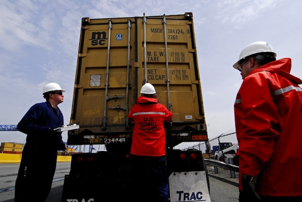 A team of Coast Guard Marine Science Technicians inspect a shipping container on the back of a truck at Conley Terminal in Boston. (U.S. Coast Guard photo by Petty Officer Second Class Luke Pinneo)