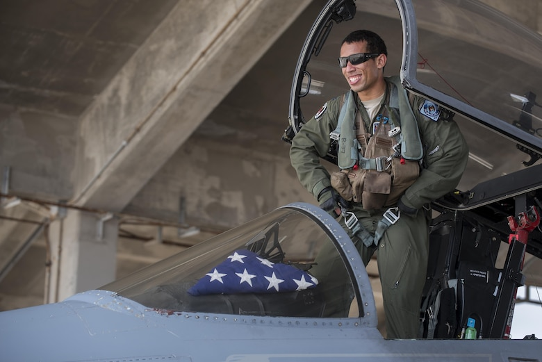 U.S. Air Force Capt. Joseph Carroll, 44th Fighter Squadron pilot, exits an F-15 Eagle Oct. 26, 2016, at Kadena Air Base, Japan. The 44th FS provides security for U.S. and coalition partners in a strategically important spot in the Indo-Asia Pacific region. (U.S. Air Force photo by Airman 1st Class Corey M. Pettis/Released)