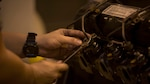 Cpl. Matthew A. Long turns a wrench on a High Mobility Multipurpose Wheeled Vehicle engine on Camp Kinser, Okinawa, Japan, October 25, 2016. Long was selected as a winner in a Marine Corps logistical innovation competition for incorporating a blood clotting agent and pain killer with a Small Arms Protective Insert to minimize the time between injury and aid. Long, from Moultrie, Georgia, is a motor transport mechanic with Motor Transport Company, Maintenance Battalion, Combat Logistics Regiment 35, 3rd Marine Logistics Group, III Marine Expeditionary Force.