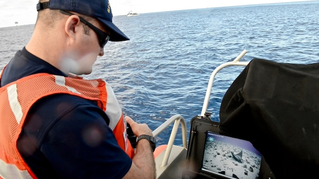 A 1st Class Petty Officer , a diver with Regional Dive Locker Pacific, locates a ray with a remotely operated vehicle off Honolulu. The crews culminated several days of training with the remotely operated vehicle by deploying it in the ocean near Oahu. (U.S. Coast Guard photo by Chief Petty Officer Sara Mooers)