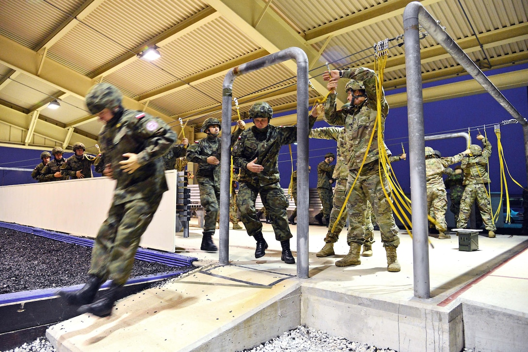 U.S. and NATO paratroopers conduct mock door exercises before participating in a Peacemaster Unity airborne operation at Aviano Air Base, Italy, Oct. 17, 2016. The U.S. paratroopers are assigned to the 173rd Airborne Brigade. Hundreds of paratroopers gathered at Aviano and simultaneously in Latvia, bringing together several partner and allied nations for one of the largest combined airborne operations. Army photo by Paolo Bovo