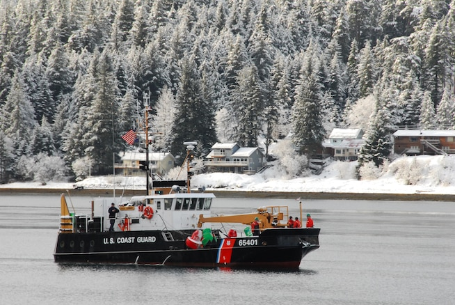 Crew members aboard the Coast Guard Cutter Elderberry, a 100-foot inland buoy tender homeported in Petersburg, Alaska, prepare buoys to be set in the channel which runs through Mendenhall Bar. (U.S. Coast Guard Photo by Petty Officer 3rd Class Walter Shinn)