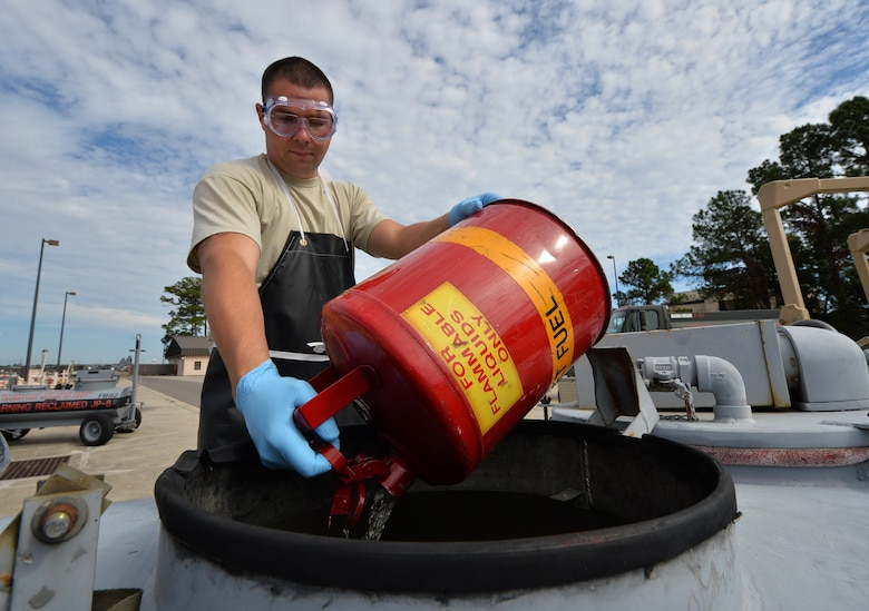 Staff Sgt. Timothy Andrews, NCO in charge of the fuels lab of the 1st Special Operations Logistics Readiness Squadron, pours reclaimed fuel into a small storage tank at Hurlburt Field Fla., Oct. 25, 2016. Reclaimable fuel is reused after testing to prevent the waste of fuel. (U.S. Air Force photo by Senior Airman Andrea Posey)
