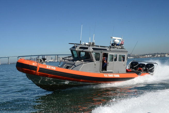 A 33-foot Special Purpose Craft maneuvers during pursuit training. Boat crews train frequently to maintain proficiency in law enforcement tactics and procedures. (U.S. Coast Guard photo by Petty Officer 1st Class Henry G. Dunphy)