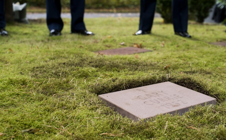 A headstone for Gary Currie, an infant who lost his life in 1952, lays in place during a dedication ceremony at the American Kindergraves in Kaiserslautern, Germany, Oct. 15, 2016. Joy Caffey, Gary's mother, does not know where her son is laid to rest. Her family reached out to the Ramstein Area Chiefs' Group and they offered to dedicate a gravestone to Gary within the Kindergraves.  (U.S. Air Force photo by Senior Airman Tryphena Mayhugh)