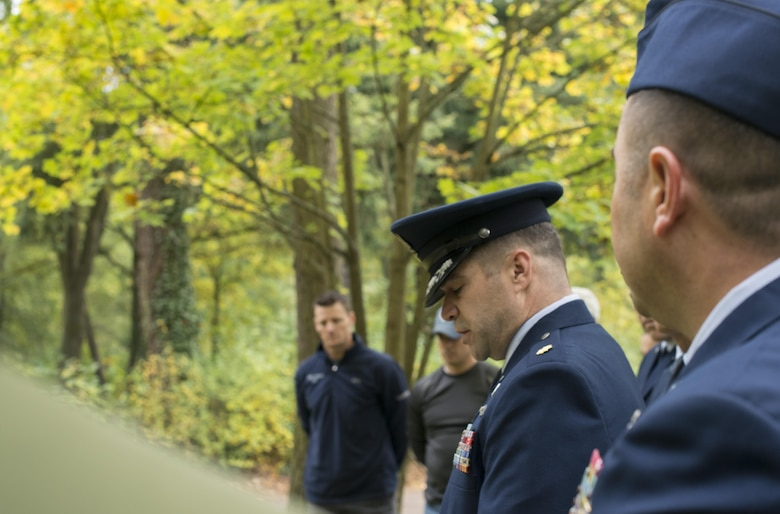 Maj. David Horton, 86th Airlift Wing chaplain, speaks at a dedication ceremony for Gary Currie, an infant who lost his life in 1952, at the American Kindergraves in Kaiserslautern, Germany, Oct. 15, 2016. Joy Caffey, Gary's mother, does not know where her son is laid to rest. Her family reached out to the Ramstein Area Chiefs' Group and they offered to dedicate a gravestone to Gary within the Kindergraves. (U.S. Air Force photo by Senior Airman Tryphena Mayhugh)