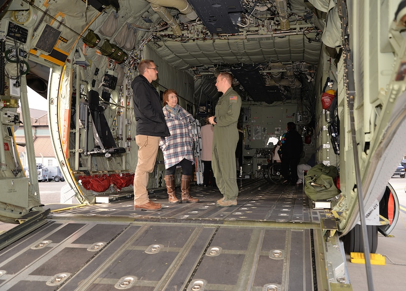 A U.S. Air Force loadmaster, right, from the 67th Special Operations Squadron, talks to families of amputees about the 352nd Special Operations Wing mission at the Steel Bones event Oct. 24, 2016, on RAF Mildenhall, England. Steel Bones is a local British organization similar to the Wounded Warrior Program, specifically aimed at amputees and their families. More than 60 people visited the base to attend the event which was also supported by the 100th Civil Engineer Squadron, 100th Security Forces Squadron and 100th Air Refueling Wing.