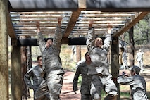 Cadets take on the obstacle course in Jacks Valley at the U.S. Air Force Academy. Cadets will tackle the obstacle course and more during the Commandant's Challenge, a rigorous 48-hour team-oriented challenge starting Oct. 28, 2016. (U.S. Air Force photo/Ray McCoy)