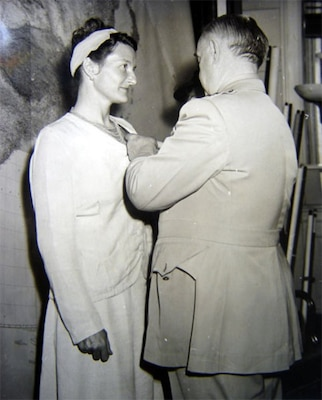 President Harry Truman received a memorandum offering the opportunity to present the Distinguished Service Cross (DSC) to Virginia Hall, May 12, 1945. She was the first civilian woman to win the award.