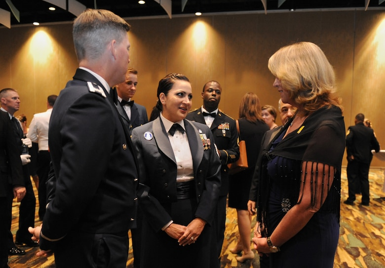 Tech Sgt. Cassandra Cruz, 81st Force Support Squadron Airman Leadership School instructor, speaks with Col. C. Mike Smith, 81st Training Wing vice commander, and Air Force Secretary Deborah Lee James during the 38th Annual Salute to the Military at the Mississippi Coast Convention Center, Oct. 25, 2016, Biloxi, Miss. James was the guest speaker at the event, which recognized the men and women who serve in the military along the Gulf Coast. Cruz was highlighted during the event for being selected as one of the 12 Air Force Outstanding Airmen of the Year. (U.S. Air Force photo by Kemberly Groue/Released)