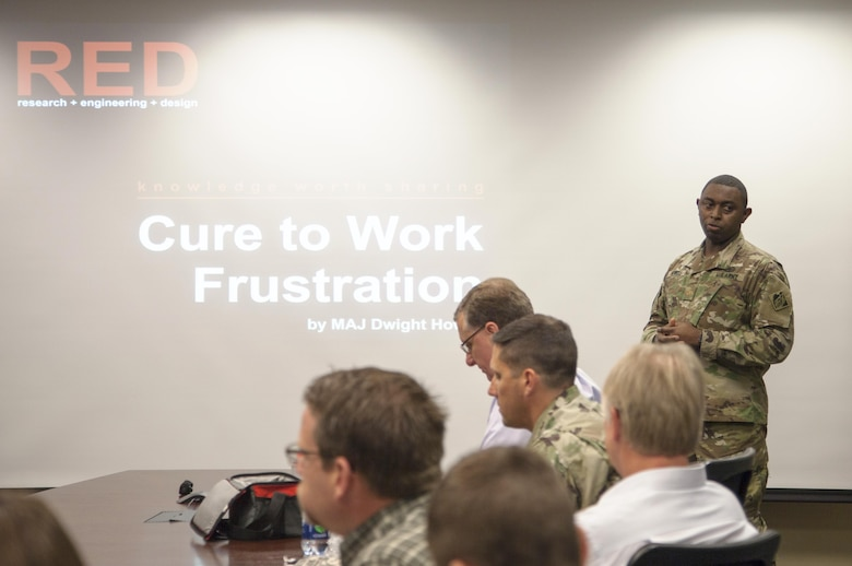 ST. PAUL, Minn. - Maj. Dwight Howell, St. Paul District quality and knowledge manager, presents the inaugural RED talk at the district's headquarters in St. Paul, Minn., Oct. 19. The RED talks, short for research, engineering and design, are designed to create a culture of sharing information within the organization.