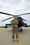 Army Warrant Officer Jessica McCormick stands in front of one of the AH-64D Apache Longbow helicopters assigned to Alpha Company, 1st Battalion, 149th Aviation Regiment, in Tupelo, Miss., Oct. 15, 2016. McCormick is the first female Apache pilot in the Mississippi Army National Guard. Army photo by Pfc. Christopher Shannon