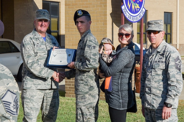 Senior Airman Colton Bess, 22nd Security Forces Squadron police service journeyman, poses with Col. Albert Miller, 22nd Air Refueling Wing commander, Chief Master Sgt. Shawn Hughes, 22nd ARW command chief, Bess's wife, Bailey, and son, Levi, Oct. 22, 2016, at McConnell Air Force Base, Kan. Bess received the spotlight performer for the week of Oct. 3-7. (U.S. Air Force photo/Senior Airman Christopher Thornbury)