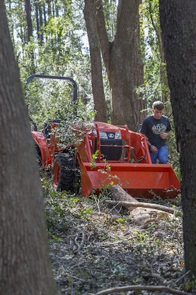 A Marine works to remove a fallen tree at another Marines' house in the local community. The volunteer is part of a recovery platoon that assists Marines and families from the air station with hurricane recovery efforts. The Marine is with Marine Aviation Logistics Squadron 31 aboard Marine Corps Air Station Beaufort.