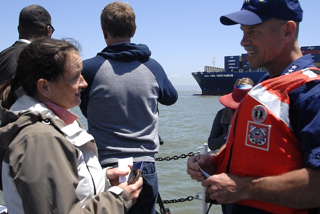 Vice Admiral Ray, speaks to a member of the San Francisco Harbor Safety Committee, aboard the Coast Guard Cutter Sockeye in the San Francisco Bay during a towing demonstration. The drill was intended as a learning experience to enhance preparedness for emergency towing operations. Coast Guard photo by Petty Officer 3rd Class Loumania Stewart (Coast Guard photo by Petty Officer 3rd Class Loumania Stewart)