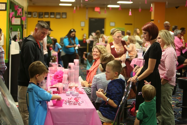 Marine Corps Community Service staff interacts with guests at the front table of the Pink Bowling Night at Marine Corps Recruit Depot Parris Island Bowling Center Oct. 25. The staff gave out door prizes and interacted with guests throughout the night. The event was one of two for breast cancer awareness month.