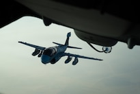 A U.S. Marine Corps EA-6B Prowler separates from a KC-10 Extender refueling operation near Iraq, Oct. 26, 2016. Prowlers specialize in interrupting enemy electronic activity and obtaining tactical electronic intelligence within the combat area. The Prowler has provided protection for strike aircraft, ground troops and ships by jamming enemy radar and communications in the support of the liberation of Mosul, Iraq. Air Force photo by Senior Airman Tyler Woodward