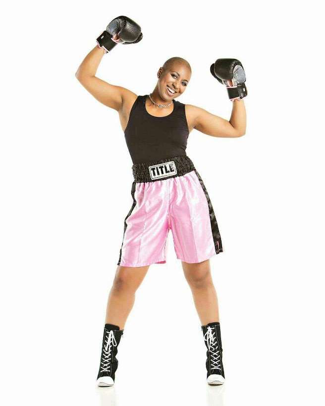 Lt. Col. Felicia Burks shows her resiliency by taking boxing while she battles breast cancer on Joint Base Elmendorf-Richardson, Alaska, in 2014. Burks ultimately defeated cancer and went on to a command position at Fairchild Air Force Base, Wash. (Courtesy photo)