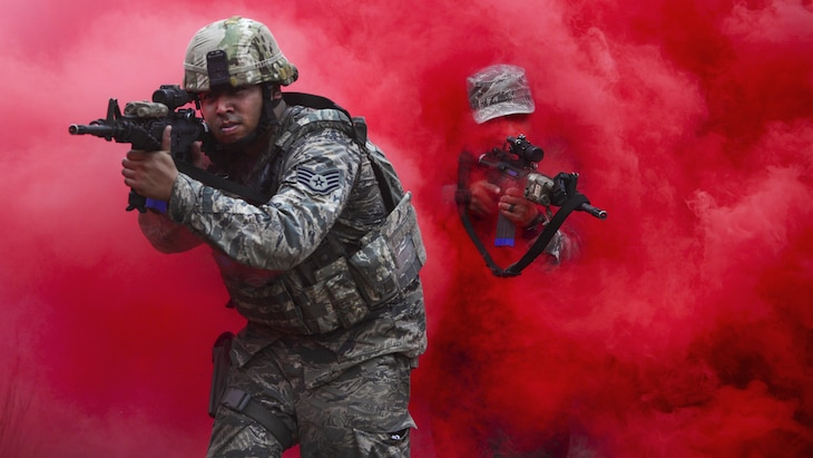 Airmen maneuver through concealing smoke during tactical combat casualty care training in Westhampton Beach, N.Y., Oct. 21, 2016. Air National Guard photo by Staff Sgt. Christopher S. Muncy