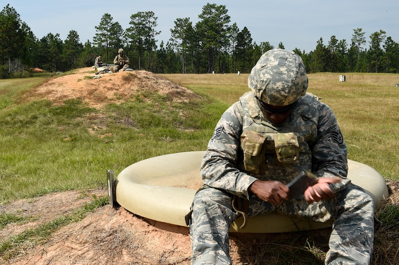 Staff Sgt. Malcolm Patterson, a heating, ventilation and air conditioning technichian with the 1st Special Operations Civil Engineer Squadron, loads a magazine with ammunition during small arms training Air Commandos from the 1st Special Operations Mission Support Group clear buildings during training at Camp Shelby, Miss., Oct 23, 2016. Air Commandos received in-depth combat arms training from combat arms training and maintenanceinstructors from the 1st Special Operations Security Forces Squadron.(U.S. Air Force photo by Senior Airman Jeff Parkinson)