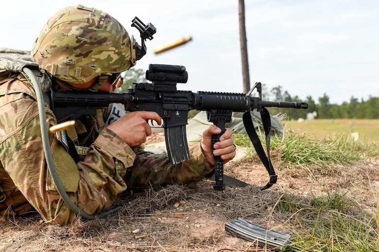 Senior Airman Parker White, a combat arms training and maintenance instructor with the 1st Special Operation Security Forces Squadron, fires his weapon during Task Force Exercise Southern Strike at Camp Shelby, Miss., Oct. 24, 2016. Air Commandos received in-depth weapons training from combat arms training and maintenance instructors with the 1st Special Operations Security Forces Squadron. (U.S. Air Force photo by Senior Airman Jeff Parkinson)