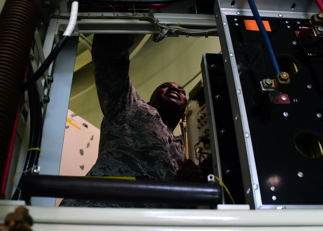 Lt. Col. Eric Welcome, 460th Space Communication Squadron commander, learns how to properly clean one of the power supply towers inside one of the radomes Oct. 20. 2016, on Buckley Air Force Base, Colo. Due to the importance of the radomes, Airmen within the 460th SCS walked Welcome through their weekly maintenance routine to insure operation readiness. (U.S. Air Force photo by Airman Holden S. Faul/ Released)