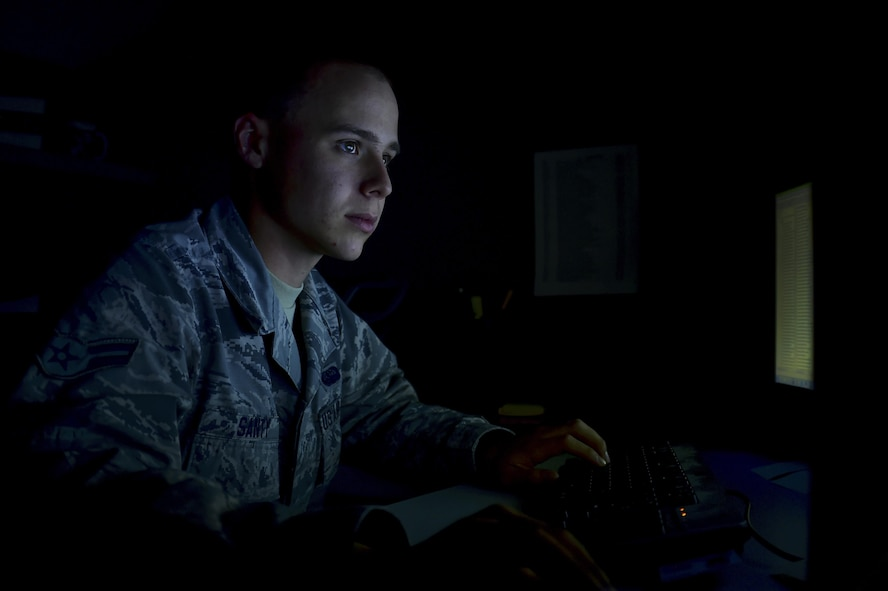 Airman 1st Class Tyler C. Santy, 460th Space Communication Squadron network administrator, reviews information Oct. 20, 2016, at Buckley Air Force Base, Colo. As a network administrator, Santy is responsible for maintaining the security of the installation's networks. (U.S. Air Force photo by Airman Holden S. Faul/ Released)