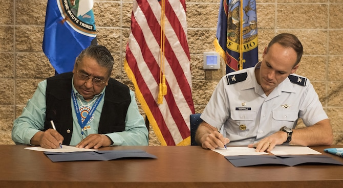 Col. Jefferson O'Donnell, 366th Fighter Wing commander, and Lindsey Manning, Chairman of the Shoshone-Paiute Tribes of the Duck Valley Indian Reservation, sign a five-year agreement at the Duck Valley Indian Reservation Oct. 20, 2016. The Duck Valley Indian Reservation, established in 1877, sits within the Mountain Home Air Force Base area of operation, creating a close relationship between base and tribal leadership. (U.S. Air Force photo by Senior Airman Connor J. Marth/Released)