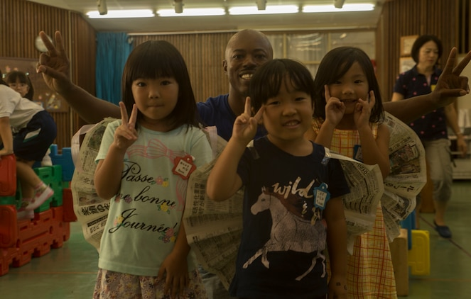 U.S. Marine Corps GySgt. Raetheon W. Mitchell, a motor transportation maintenance chief at Garrison Mobile Equipment, Marine Corps Base Smedley Butler, III Marine Expeditionary Force, visits Chatan-Daini Kindergarten to give back to the community in Okinawa, Japan, Oct. 26, 2016. The Marines were able to show the local children the similarities between the U.S. and Japanese cultures through a variety of games and books. (U.S. Marine Corps photo by Lance Cpl. Kelsey Dornfeld)