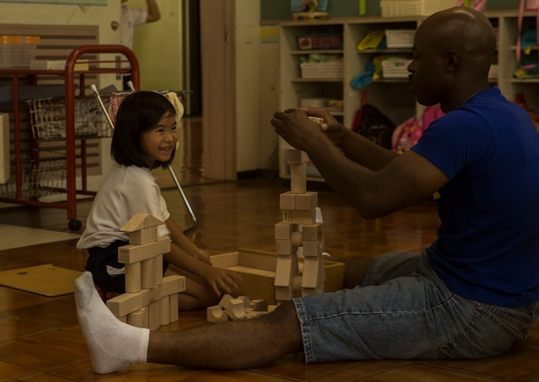 U.S. Marine Corps GySgt. Raetheon W. Mitchell, a motor transportation maintenance chief at Garrison Mobile Equipment, Marine Corps Base Smedley Butler, III Marine Expeditionary Force, builds block towers with a student at the Chatan-Daini Kindergarten during a visit to the school in Okinawa, Japan, Oct. 26, 2016. The Marines were able to show the local children the similarities between U.S. and Japanese cultures through a variety of games and books. (U.S. Marine Corps photo by Lance Cpl. Kelsey Dornfeld)