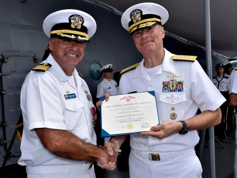 POLARIS POINT, Guam (Oct. 21, 2016) Rear Adm. Frederick J. Roegge, commander of Submarine Force, U.S. Pacific Fleet, right, awards the Legion of Merit to Capt. Mark A. Prokopius, left, the commanding officer of the submarine tender USS Emory S. Land (AS 39). Prokopius received the award during the change-of-command ceremony aboard Emory S. Land. (U.S. Navy photo by Seaman Daniel S. Willoughby/RELEASED)